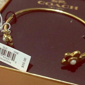 NIB- COACH flower gold statement bangle